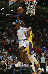 March 1, 2018 - Miami, FL, USA - The Miami Heat's Justise Winslow, left, goes to the basket against the Los Angeles Lakers' Brandon Ingram during the first quarter at the AmericanAirlines Arena in Miami on Thursday, March 1, 2018. The Lakers won, 131-113. (Credit Image: © David Santiago/TNS via ZUMA Wire)