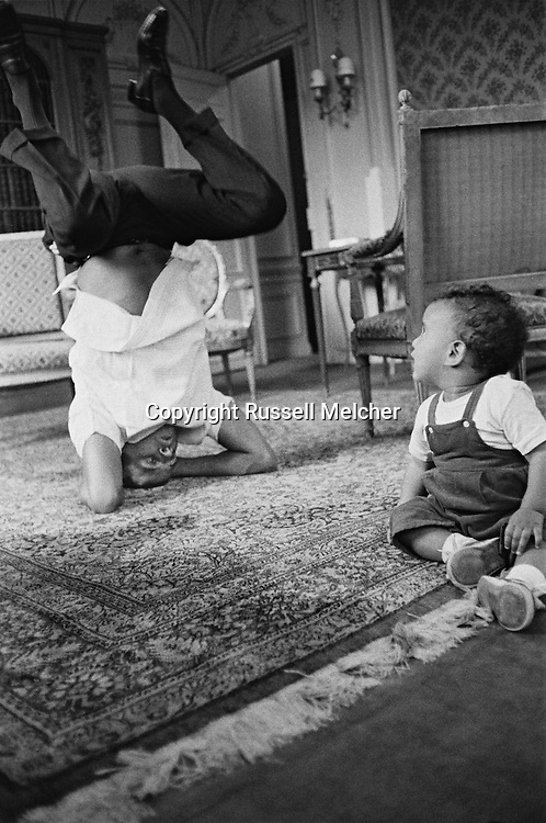 Harry Belafonte having fun with his son David at H&ocirc;tel Raphael in Paris.<br /> This picture appeared full page in the french paper, &quot; Paris Jours&quot;.<br /> <br /> <br /> Harry Belafonte jouant avec son fils David dans sa suite a  H&ocirc;tel Raphael &agrave; Paris .<br /> Cette image as ete publie en pleine page dans le journal fran&ccedil;ais , &quot;Paris Jours &quot; .