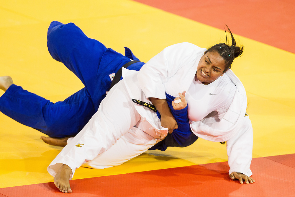 Maria Suelen Altheman (in white) of Brazil takes down  Emileidys Lopez of Venezuela to win their 1/4 final contest in the women's judo +78kg class at the 2015 Pan American Games in Toronto, Canada, July 14,  2015.  AFP PHOTO/GEOFF ROBINS