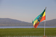 An Ethiopian flag in front of lake Hawassa.