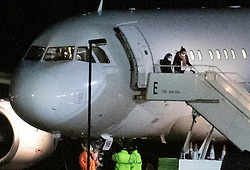 © Licensed to London News Pictures. 02/02/2020. Brize Norton, UK. Ground crew watch as two passengers, who were evacuated from Wuhan in China, disembark at RAF Brize Norton in Oxfordshire. On Friday 83 Britons were flown from the centre of the coronavirus outbreak to RAF Brize Norton and then transported to quarantine for 14 days at Arrowe Park Hospital on the Wirral. Photo credit: Peter Macdiarmid/LNP