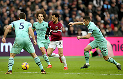West Ham United's Felipe Anderson battles for possession with Arsenal players