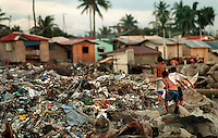 Where the city dump ends Cavite City Cemetery begins--as does the shanty town that is built among the graves.  World Vision attempted to relocate 50 families from the cemetery to a smaller town about 10 miles away.  Ten families have since returned to as they could not make a living in the more remote locale. (Janet Jensen/The News Tribune)