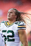 KANSAS CITY, MO - AUGUST 29:  Clay Matthews #52 of the Green Bay Packers warms up before the last preseason game against the Kansas City Chiefs at Arrowhead Stadium on August 29, 2013 in Kansas CIty, Missouri.  (Photo by Wesley Hitt/Getty Images) *** Local Caption *** Clay Matthews