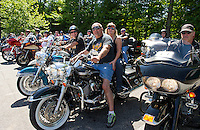 Riders prepare to leave the Naswa Resort for the annual Makris Memorial Ride around Lake Winnipesaukee on Saturday morning.  (Karen Bobotas/for the Laconia Daily Sun)