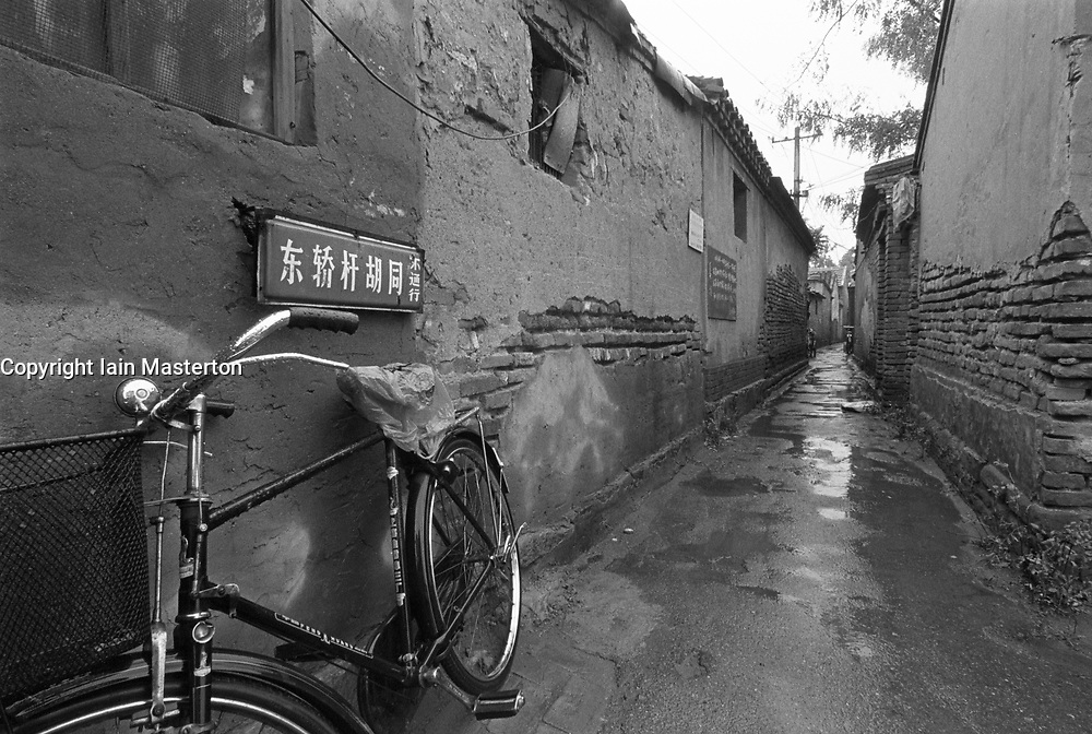 Bicycle leaning on wall in hutong in Beijing China
