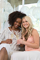 Two young women celebrating at bridal shower