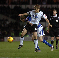 Photo: Kevin Poolman.<br />Derby County v Leicester City. Coca Cola Championship. 25/11/2006. Morten Bisgaard of Derby is held back by Richard Stearman of Leicester.