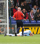 Dundee's Jim McAlister collapses after being hit by a shot from Ross County's Rocco Quinn - Ross County v Dundee, SPFL Premiership at the Global Energy Stadium, Dingwall<br /> <br />  - &copy; David Young - www.davidyoungphoto.co.uk - email: davidyoungphoto@gmail.com