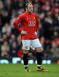 A dejected Wayne Rooney of Manchester United reflects during the Barclays Premier League match between Manchester United and Liverpool at Old Trafford on March 14, 2009 in Manchester, England.
