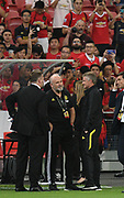 Manchester United manager Ole Gunnar Solskaer and assistant Mike Phelan talk before the game, an International Champions Cup game won by Manchester United 1-0 , Saturday, July 20, 2019, in Singapore. (Kim Teo/Image of Sport)