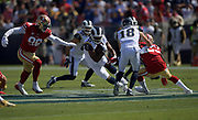 Los Angeles Rams running back Malcolm Brown (34) runs with the ball while San Francisco 49ers defensive tackle DeForest Buckner (99) defends.during an NFL football game, Sunday, Oct. 13, 2019, in Los Angeles. The 49ers defeated the Rams 20-7. (Dylan Stewart/Image of Sport)