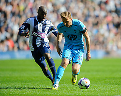 Harry Kane (ENG) of Tottenham Hotspur is challenged by Youssuf Mulumbu (COD) of West Brom - Photo mandatory by-line: Rogan Thomson/JMP - 07966 386802 - 12/04/2014 - SPORT - FOOTBALL - The Hawthorns Stadium - West Bromwich Albion v Tottenham Hotspur - Barclays Premier League.
