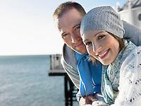 Couple standing on pier portrait