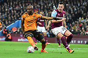 Wolverhampton Wanderers defender (on loan from Porto ) Willy Boly (15) turns Aston Villa defender John Terry (26) during the EFL Sky Bet Championship match between Aston Villa and Wolverhampton Wanderers at Villa Park, Birmingham, England on 10 March 2018. Picture by Dennis Goodwin.