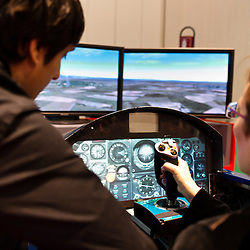 Milan, Italy - February  17: A visitor tries a flight simulator at BIT International Tourism Exchange on february 17, 2012 in Milan, Italy.