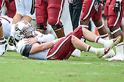 September 28, 2013 - Orlando, FL, U.S:  South Carolina Gamecocks quarterback Connor Shaw (14) grabs his shoulder after being tackled during 1st half NCAA football game action between the South Carolina Gamecocks and the UCF Knights at Bright House Networks Stadium in Orlando, Fl