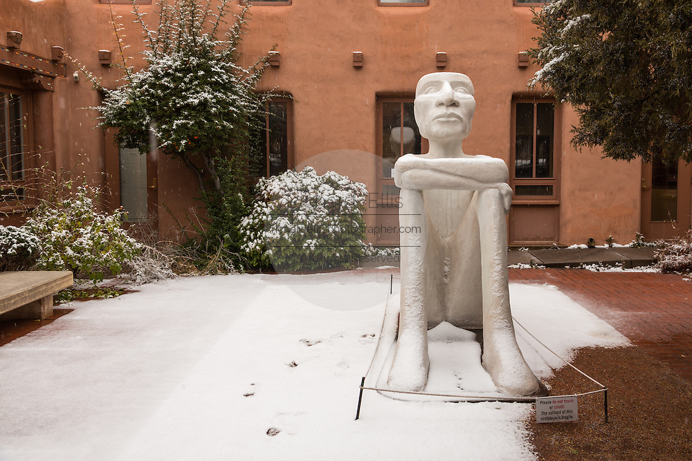 A sculpture covered in snow at the Museum of Contemporary Native Arts in the historic district during a winter snowfall December 12, 2015 in Santa Fe, New Mexico.