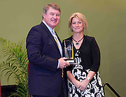 ACC Commissioner John D. Swofford presents former Georgia Tech star Tory Ehle-Rule with her Women's ACC Legends Award at the 2011 ACC Legends Banquette held at the Terrace Greensboro Coliseum Complex in Greensboro, North Carolina.  (Photo by Mark W. Sutton)