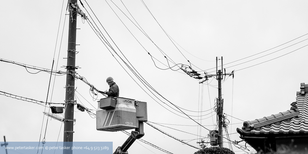 Japanese electrical street supply worker.
