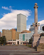 The  skyline of the city of Denver, Colorado, is a mixture that reflects the modern city but does not forgrt its western prarie roots.