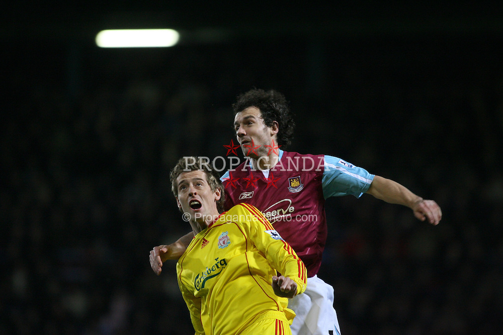 London, England - Tuesday, January 30, 2007: Liverpool's Peter Crouch and West Ham United's Christian Dailly during the Premiership match at Upton Park. (Pic by Chris Ratcliffe/Propaganda)