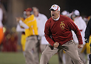 November 18, 2011: Iowa State Cyclones head coach Paul Rhoads is pumped up after a fourth down stop during the first half of the NCAA football game between the Oklahoma State Cowboys and the Iowa State Cyclones at Jack Trice Stadium in Ames, Iowa on Friday, November 18, 2011. At halftime Oklahoma State was leading Iowa State 17-7.