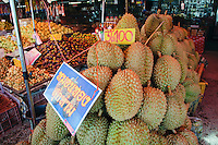 Durian - king of the tropical fruit. Pungent sweet custard like flesh in segmented pods from a very hard and spiky fruit.