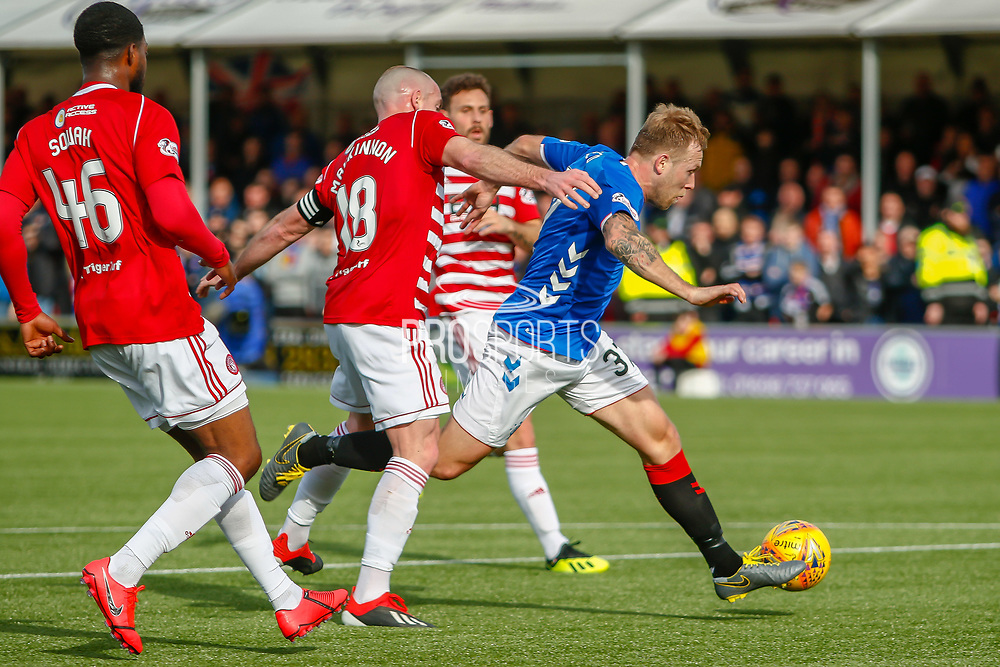 Scott Arfield gets goalside of Darian MacKinnon and a heavy touch lets him down during the Ladbrokes Scottish Premiership match between Hamilton Academical FC and Rangers at The Hope CBD Stadium, Hamilton, Scotland on 24 February 2019.