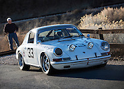 Image of a white 1964 Porsche 901 coupe in Nevada, American Southwest