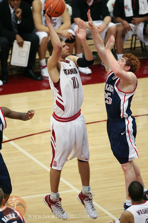 January 31, 2007; Stanford, CA, USA; Stanford Cardinal forward Brook Lopez (11) shoots the basketball against Gonzaga Bulldogs guard David Pendergraft (25) during the game at Maples Pavilion. The Bulldogs defeated the Cardinal 90-86.