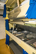 "Bunks in crew quarters of 1944 USS Missouri, Pearl Harbor, Oahu, Hawaii, USA. Ordered in 1940 and active in June 1944, the USS Missouri (""Mighty Mo"") was the last battleship commissioned by the United States. She is best remembered as the site of the surrender of the Empire of Japan which ended World War II on September 2, 1945 in Tokyo Bay. In the Pacific Theater of World War II, she fought in the battles of Iwo Jima and Okinawa and shelled the Japanese home islands. She fought in the Korean War from 1950 to 1953. Decommissioned in 1955 into the United States Navy reserve fleets (the ""Mothball Fleet""), she was reactivated and modernized in 1984 and provided fire support during Operation Desert Storm in January-February 1991. The ship was decommissioned in March 1992. In 1998, she was donated to the USS Missouri Memorial Association and became a museum at Pearl Harbor, on the island of Oahu, Hawaii, USA."