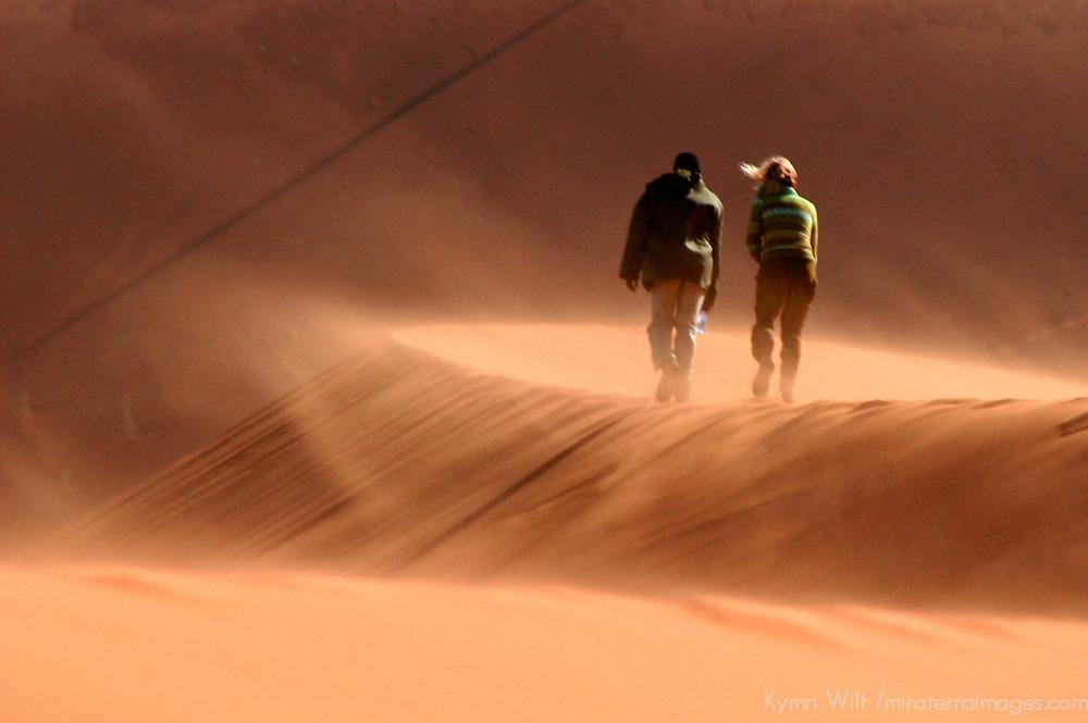 Africa, Namibia, Sossusvlei. Two people walking the windblown dunes at Sossussvlei,