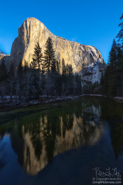"""El Capitan, a 7,573-foot (2,308 meter) granite peak is reflected in the Merced River as it flows through Yosemite National Park, California. El Capitan is one of the most prominent peaks in the Yosemite Valley and its name is the Spanish word for """"captain,"""" an homage to its Native American name, which meant """"chief."""""""