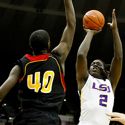 December 29, 2011; Baton Rouge, LA; LSU Tigers forward Johnny O'Bryant (2) shoots over Grambling State Tigers center Peter Roberson (40) during the first half of a game at the Pete Maravich Assembly Center.  Mandatory Credit: Derick E. Hingle-US PRESSWIRE