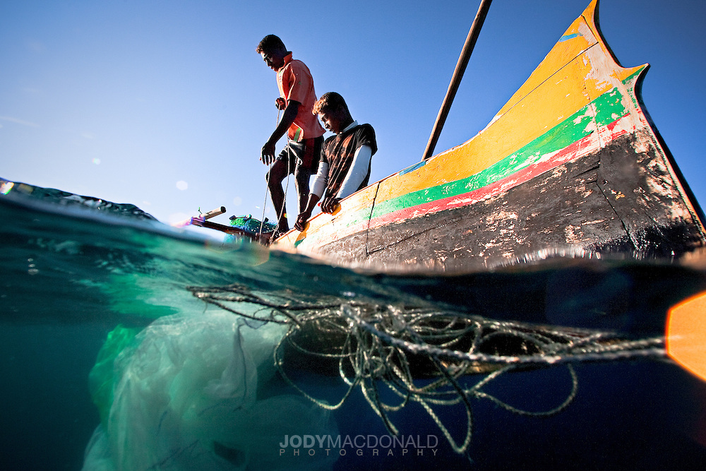 Two local Vezo fishermen ply the waters off Anakao for fish and octopus hoping to bring food back to their families.  They fish now as they have for millenia.