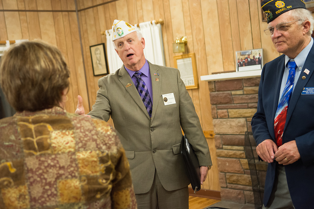 Commander Dave Evans, left, of the American Legion Department of Nevada and Post 1 Commander Jack Edstrom speak with Lisa Howard, Director of Veterans Affairs Sierra Nevada Health Care System following a System Worth Saving town hall at Post 1 in Reno, Nev. on Tuesday, March 8, 2016. Photo by David Calvert /The American Legion.
