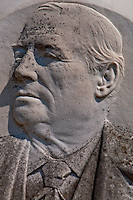 Detail of a bas relief of a man on a grave in Isola San Michel in Venice, Italy.