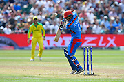 Najibullah Zadran of Afghanistan fends off a short ball from Pat Cummins of Australia during the ICC Cricket World Cup 2019 match between Afghanistan and Australia at the Bristol County Ground, Bristol, United Kingdom on 1 June 2019.
