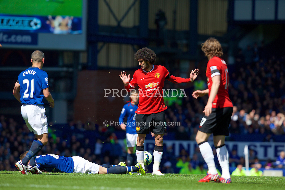 LIVERPOOL, ENGLAND - Sunday, April 26, 2015: Everton's Ross Barkley is fouled by Manchester United's Marouane Fellaini during the Premier League match at Goodison Park. (Pic by David Rawcliffe/Propaganda)