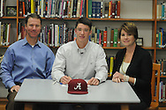Oxford High baseball player William Elliott (center), with his parents Allen (left) and Kathryn Elliott, signs to play baseball at Alabama, in Oxford, Miss. on Wednesday, November 14, 2012.
