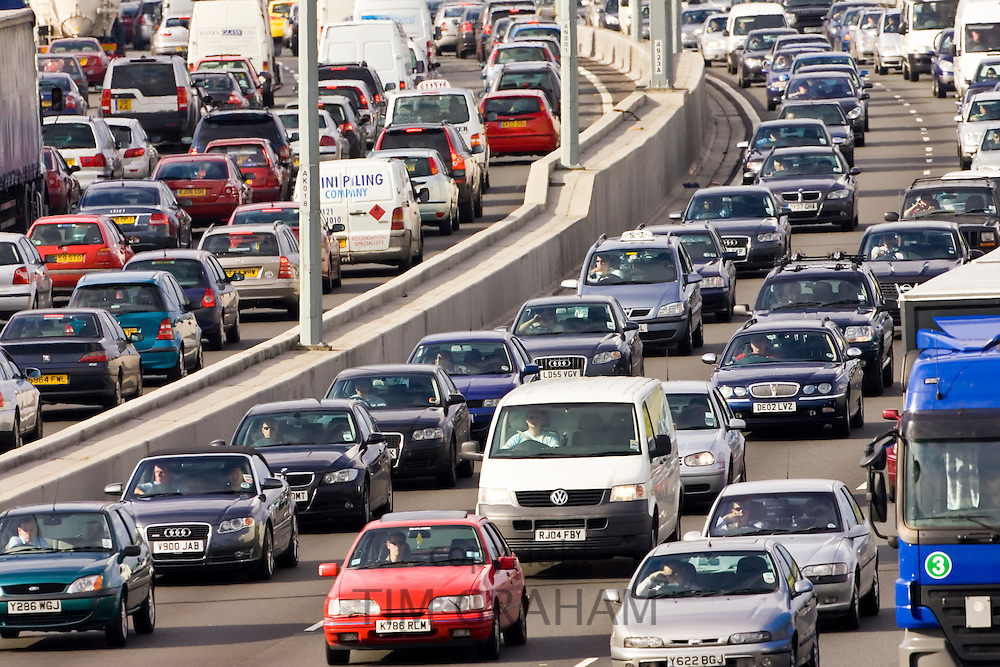 Traffic congestion of cars and vans in both directions on M25 motorway, near London, United Kingdom