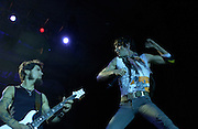 Perry Farrell and Dave Navarro of Jane's Addiction performing at the 2003 Gravity Games at the the North Coast Harbor behind the Rock and Roll Hall of Fame in Cleveland Ohio.  Photo by Bryan Rinnert/3Sight Photography