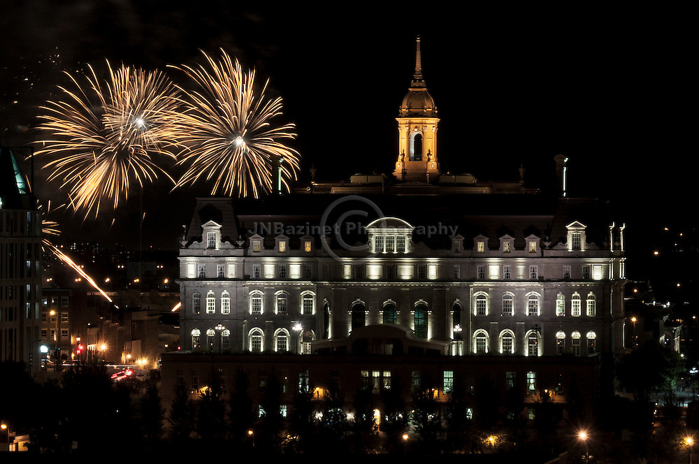 Fireworks behind City Hall in Old Montreal mark the 2011 Tall Ships event, QC