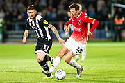Salford City midfielder Danny Whitehead challenged by Grimsby Town midfielder Jordan Cook during the EFL Sky Bet League 2 match between Salford City and Grimsby Town FC at Moor Lane, Salford, United Kingdom on 17 September 2019.