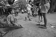 Vietnam, Hanoi: sugar cane streetseller