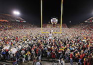 November 18, 2011: Iowa State Cyclone fans storm the field after the the NCAA football game between the Oklahoma State Cowboys and the Iowa State Cyclones at Jack Trice Stadium in Ames, Iowa on Friday, November 18, 2011. Iowa State upset Oklahoma State 37-31 double overtime.