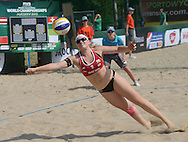 STARE JABLONKI POLAND - July 2:   Katharina Schutzenhofer /2/ of Austria in action during Day 2 of the FIVB Beach Volleyball World Championships on July 2, 2013 in Stare Jablonki Poland.  (Photo by Piotr Hawalej)