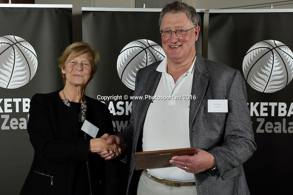Paul Duggan (CEO Canterbury Basketball) receives a Hall of Fame plaque on behalf of Maurice A. (Jerry) McDougall (deceased)      from Karen Poutasi during the Basketball New Zealand awards evening at the Mercure Hotel in Wellington on Friday the 20th of May 2016. Copyright Photo by Marty Melville / www.Photosport.nz