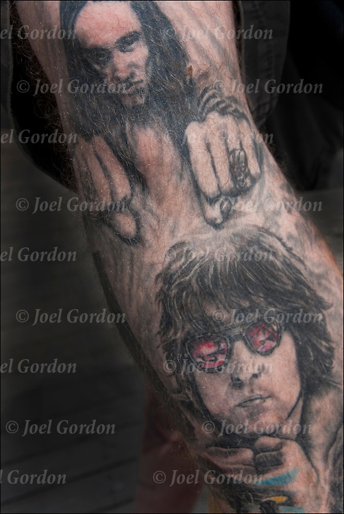 Close up tattoo on his leg.<br /> <br /> Body art or tattoos has entered the mainstream it is known longer considered a weird kind of subculture.<br /> <br /> According to a 2006 Pew survey, 40% of Americans between the ages of 26 and 40 have been tattooed&quot;.